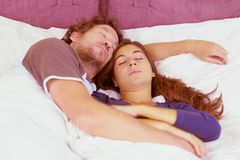 Couple sleeping in bed peacefully Stock Images