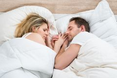 Couple sleeping in bed Stock Image