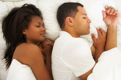 Couple Sleeping In Bed Together Stock Photography