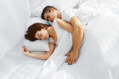 Couple sleeping in bed Royalty Free Stock Images