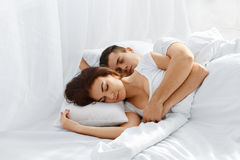 Couple sleeping in bed Stock Images