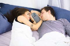 Couple sleeping on bed Stock Images