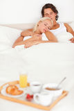 Couple sleeping with the breakfast on a tray Stock Photo