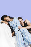 Couple sleeping on couch Stock Photo