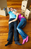 Couple sleeping on the floor. Moving house Royalty Free Stock Photography