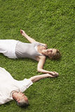 Couple Sleeping On Grass Stock Images