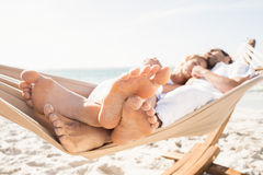 Couple sleeping in hammock Stock Images