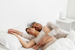 Couple sleeping in his bed Royalty Free Stock Images