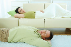 Couple sleeping at home Stock Photos