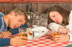 Couple sleeping after a huge alcoholic Dinner Stock Image