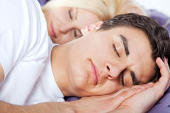 Couple sleeping late Royalty Free Stock Image