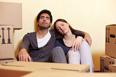 Couple sleeping between packing Stock Photography