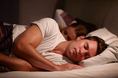 Couple Sleeping Peacefully In Bed Together Stock Photos