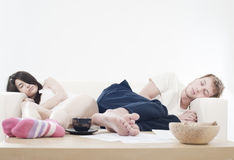 Couple sleeping separate Royalty Free Stock Image