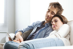 Couple sleeping on sofa Royalty Free Stock Images