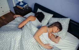 Couple sleeping on their backs. Top view of young couple sleeping on their backs in bed stock photos