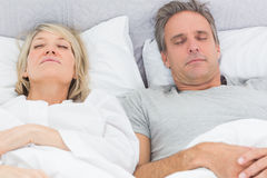 Couple sleeping in their bed Royalty Free Stock Images