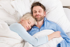 Couple Sleeping Together In Bed Stock Photo