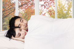 Couple sleeping together on bedroom Royalty Free Stock Image