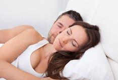 Couple sleeping together Stock Photo