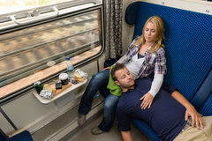Couple sleeping while traveling with train tired. Men women resting royalty free stock images