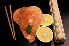 Couple slices of raw salmon stock image