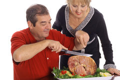 Couple slicing ham Royalty Free Stock Photos