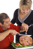 Couple slicing ham vertical Royalty Free Stock Photo