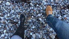 Couple slow walking on a gravel stock video footage