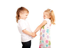 Couple small children holding hands. And looking at each other. Love and valentine's day concept. Isolated on white background Royalty Free Stock Photos