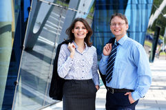 A couple of smart business persons in formal clothes Stock Photography