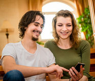 Couple with smartphone Stock Photos