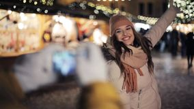 Couple with smartphone photographing at christmas stock video footage