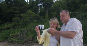 Couple with Smartphone and Selfie Stick stock video