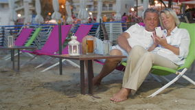 Couple with Smartphone on the Sun Lounger stock footage