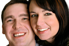 Couple - Smile. Portrait of man and woman. Main focus is on the woman Royalty Free Stock Images