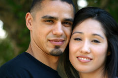 Couple Smiling. Very attractive young hispanic couple smiling Royalty Free Stock Photography