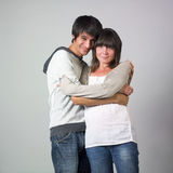 Couple smiling. Young pretty couple posing and smiling to the camera Royalty Free Stock Photo