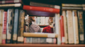 Couple Smiling Behind Books Royalty Free Stock Photo