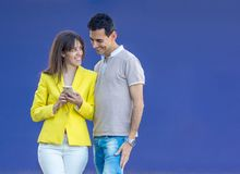 Couple smiling on blue background stock image