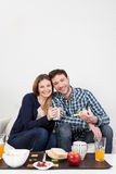 Couple smiling in breakfast Stock Images