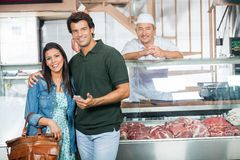 Couple Smiling In Butchery Stock Image