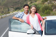 Couple smiling at the camera Royalty Free Stock Photos