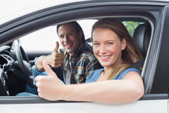 Couple smiling at the camera with thumbs up Stock Photography