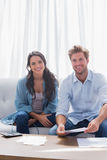 Couple smiling while doing their accounts Royalty Free Stock Photography