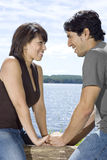 Couple Smiling at Each other Outdoors Stock Photos