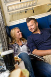 Couple smiling at each other in train Stock Photos