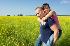 Couple smiling on a field Royalty Free Stock Photography