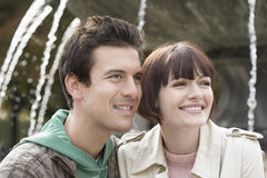 Couple Smiling In Front Of Fountain Stock Photography