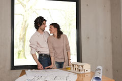 Couple smiling about house plans Royalty Free Stock Photos